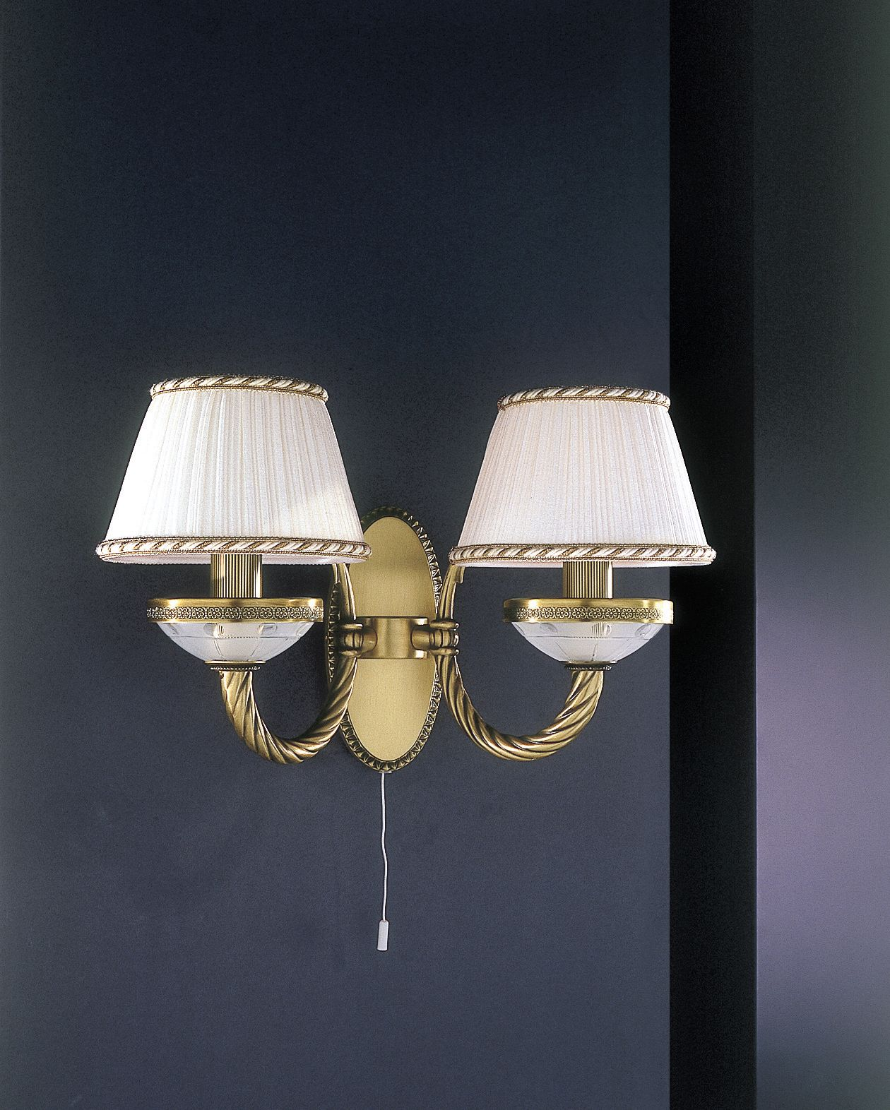 2 light brass and frosted glass wall sconce with lamp shade