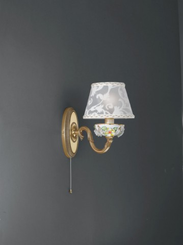 1 light golden brass and painted porcelain wall sconce with lamp shade