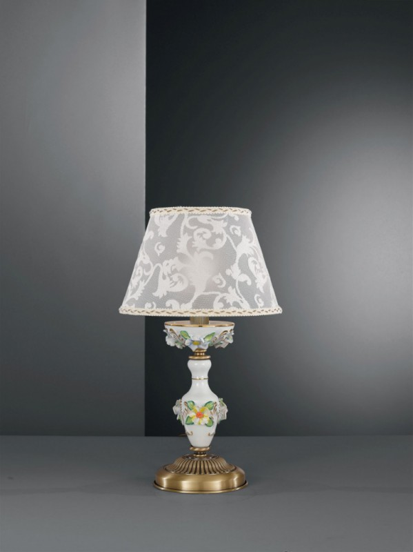 Brass bedside lamp with painted porcelain and lamp shade