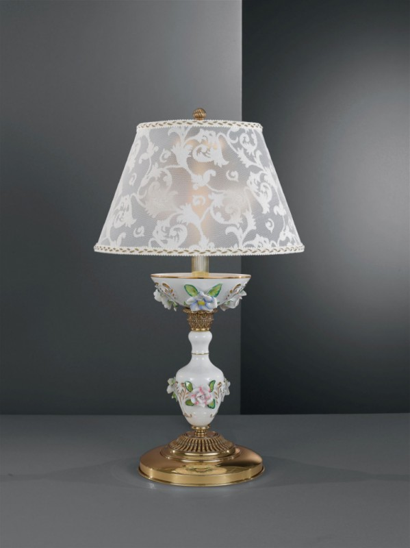 Golden brass table lamp with white porcelain and lamp shade