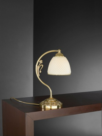 Golden brass bedside lamp with ivory glass