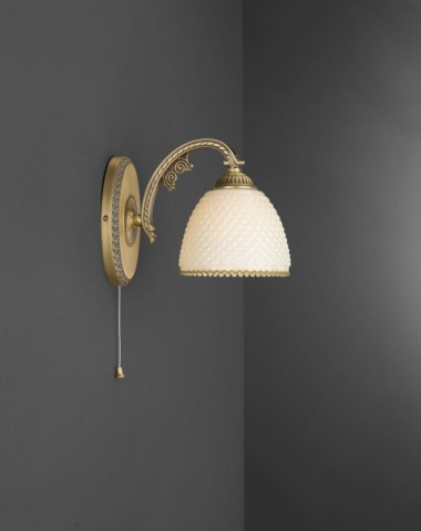 Brass wall sconce with ivory glass