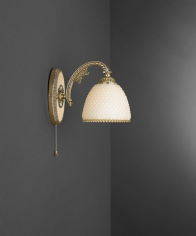 Golden brass wall sconce with ivory glass