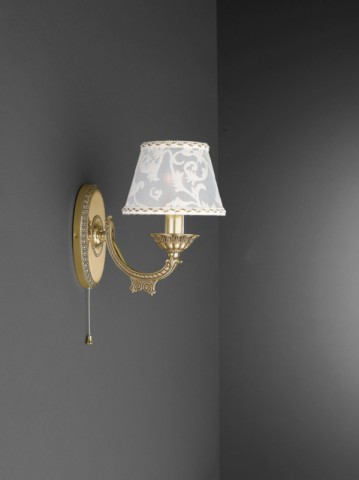 1 light golden brass wall sconce with lamp shade
