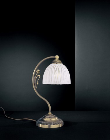 Brass bedside lamp with striped glass