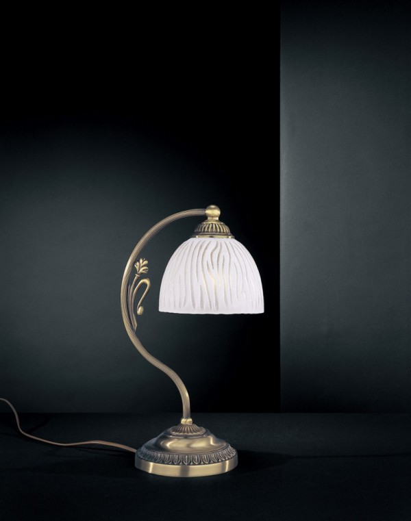 Brass bedside lamp with white striped glass