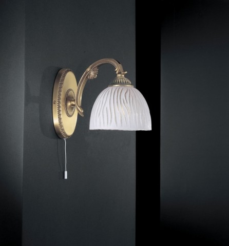 Brass wall sconce with white striped glass