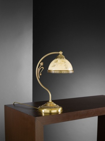 Brass bedside lamp with decorated cream glass