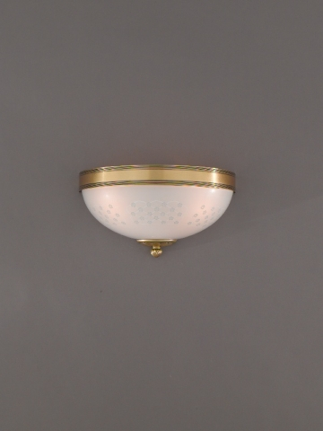 Brass wall light with decorated